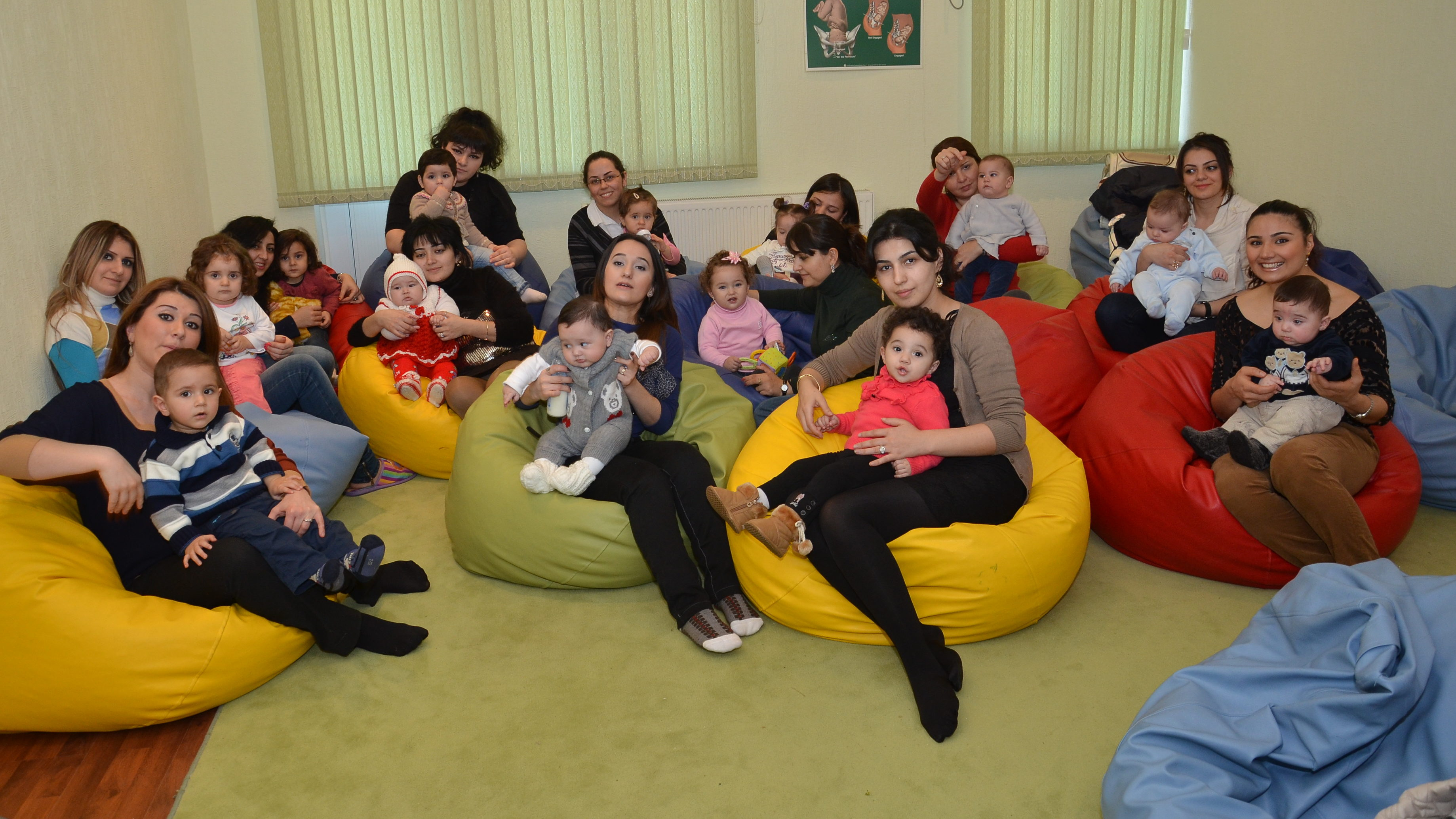 """Several special guests accompany their mothers during """"Baby day"""" at WARD's maternity school."""
