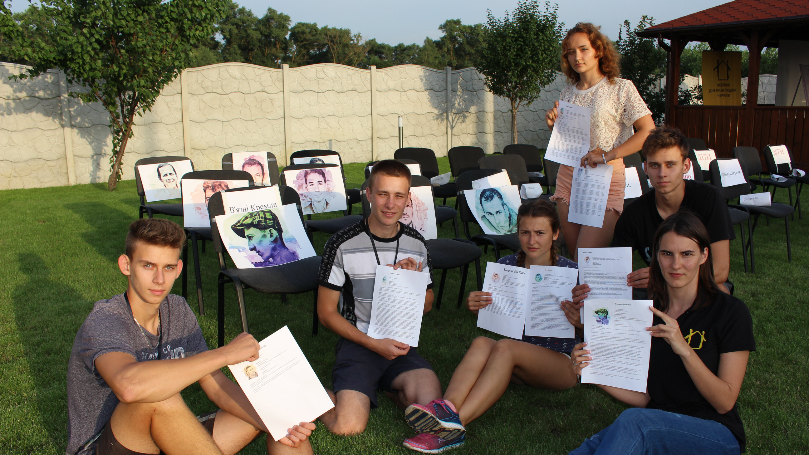 Participants of the festival, shown here with portraits and information about imprisoned human rights defenders.