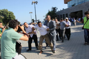 "2012: Mehman Huseynov (left in striped shirt) documents ""Sing for Democracy"" action in Baku."