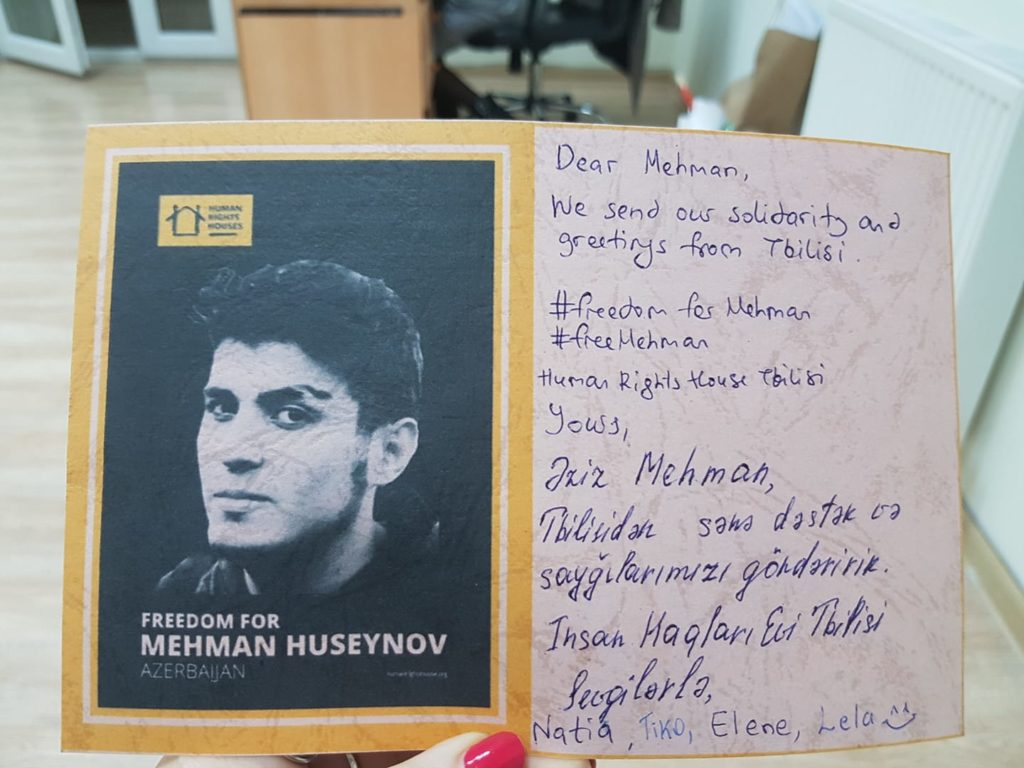 Human Rights House Tbilisi signs a postcard to send to Mehman Huseynov.