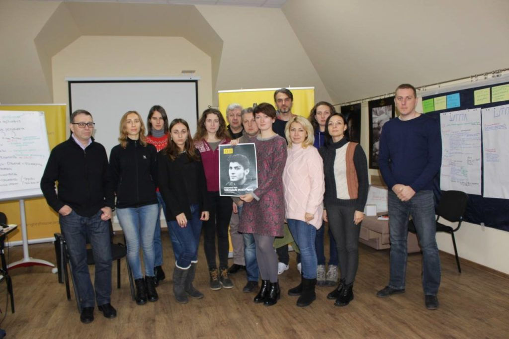 "Participants of a planning session for Educational Human Rights House Chernihiv's ""Understanding Human Rights"" show their support for Mehman Huseynov."